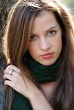 Woman in green scarf Stock Images