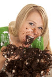 Woman green shirt with cake handful eat Stock Images