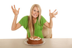 Woman green shirt with cake hands out Stock Photos