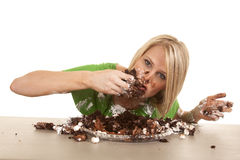 Woman green shirt with cake lean eat Royalty Free Stock Images