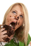 Woman green shirt with cake mess close look up Stock Photo