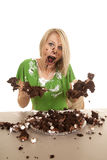 Woman green shirt with cake mouth open hands out messy Royalty Free Stock Photos