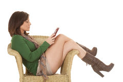 Woman green shirt legs tablet chair side Royalty Free Stock Images