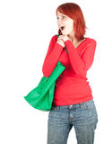 Woman with green shopping bag Royalty Free Stock Photography