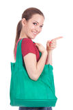 Woman with green shopping bag Stock Image