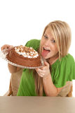 Woman green shrt with cake lick Royalty Free Stock Images