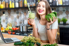 Woman with green smoothie Royalty Free Stock Image