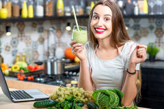 Woman with green smoothie Royalty Free Stock Photography