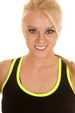 Woman green sports attire close smile Royalty Free Stock Image