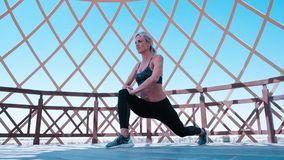 Woman in Green Sports Bra and Black Leggings Doing Leg Lunges Royalty Free Stock Photos