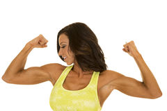 Woman in green sports bra flex looking to side Royalty Free Stock Image