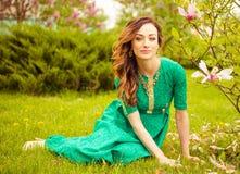 Woman in green at spring garden Stock Photos