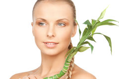 Woman with green sprout Stock Photos