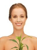 Woman with green sprout Royalty Free Stock Photos