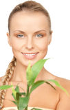 Woman with green sprout Royalty Free Stock Image
