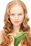 Woman with green sprout Stock Photo