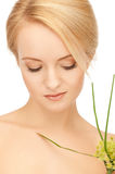 Woman with green sprout Stock Image