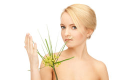 Woman with green sprout Stock Photography
