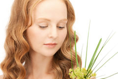 Woman with green sprout Royalty Free Stock Photo