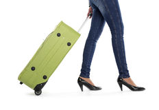 Woman with green suitcase. Stock Photo