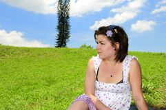 Woman on green summer grass Royalty Free Stock Photography