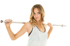 Woman green tank fitness bar on back serious Royalty Free Stock Photo