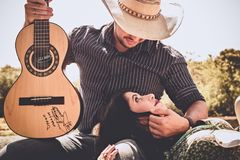 Woman In Green Top With Man In Black Long-sleeved Shirt Holding Autographed Brown Guitar Royalty Free Stock Photos