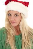 Woman green top santa hat look Stock Photo
