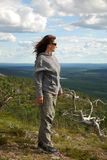 Woman on the green top of summer Finland. Royalty Free Stock Photography