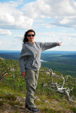 Woman on the green top of summer Ruka. Stock Photo