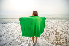 Woman in green towel on the beach Royalty Free Stock Images