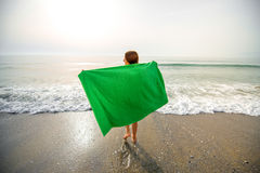 Woman in green towel on the beach Royalty Free Stock Photos