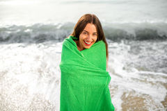 Woman in green towel on the beach Stock Photos