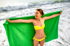 Woman in green towel on the beach Royalty Free Stock Photo