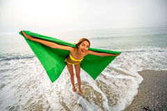 Woman in green towel on the beach Stock Images