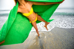 Woman in green towel on the beach Royalty Free Stock Image