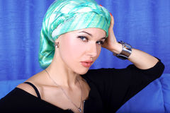 Woman in green turban Stock Images