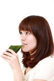 Woman with green vegetable juice Stock Photos
