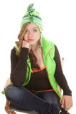 Woman green vest thinking Stock Images
