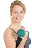 Woman with green weights Royalty Free Stock Images