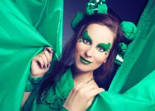 Woman in green. Stock Image