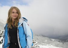 Woman in Green Zip Hooded Jacket on White Mountain With Fogs during Daytime Stock Image
