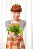 Woman with greenery Stock Image