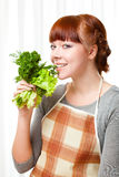 Woman with greenery Stock Photo