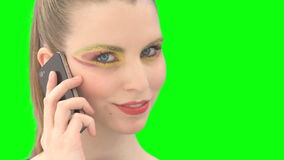 Woman with greenscreen and alpha matte stock footage