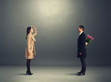 Woman greeting her boyfriend with flowers Royalty Free Stock Images