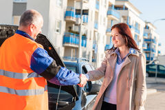 Woman greeting mechanic after her car breakdown. Problem men technician stock photography