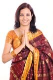 Woman greeting namaste Royalty Free Stock Image