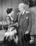Woman greeting an older man Stock Image