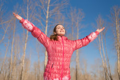 Woman greeting the sun Royalty Free Stock Photography